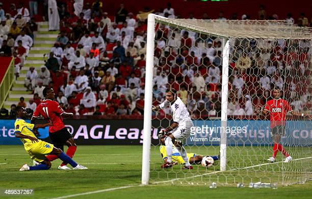 Ahmed Khalil of Al Ahli scores the second goal duirng the Arabian Gulf football league match between Al Ahil and Al Dhafra at Rashid Stadium on May...
