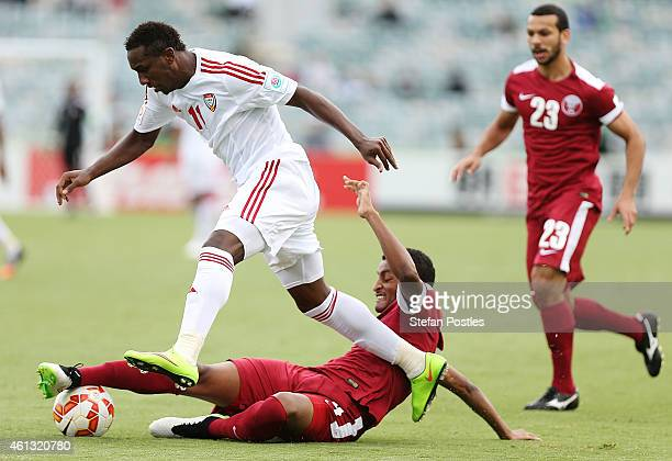Ahmed Khalil of the United Arab Emirates and Almahdi Ali Mukhtar of Qatar contests possession during the 2015 Asian Cup match between the United Arab...
