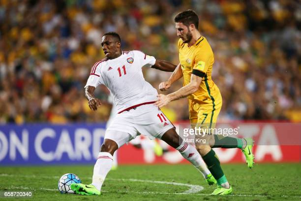 Ahmed Khalil of the United Arab Emirates is challenged by Mathew Leckie of the Socceroos during the 2018 FIFA World Cup Qualifier match between the...