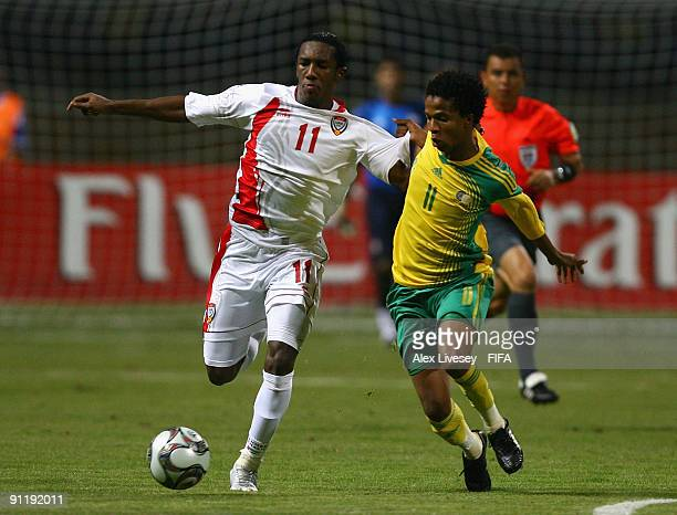 Ahmed Khalil of United Arab Emirates holds off a challenge from Philani Khwela of South Africa during the FIFA U20 World Cup Group F match between...