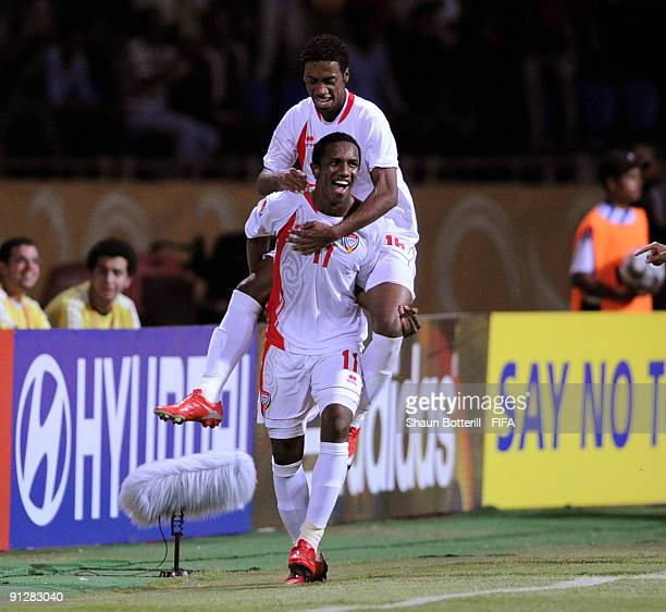 Ahmed Khalil of United Arab Emirates is congratulated by teammate Mohamed Fayez after scoring the FIFA U20 World Cup Group F match between United...