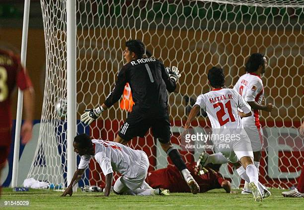 Ahmed Khalil of United Arab Emirates sees his shot beat goalkeeper Rafael Romo of Venezuela to score the winning 21 goal during the FIFA U20 World...