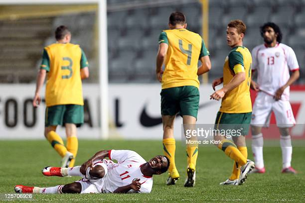 Ahmed Khalil Sebait Mubarak Aljunaibi of the UAE after being tackled hard by Matthew Jurman of Australia during the third round 2012 Olympic Games...