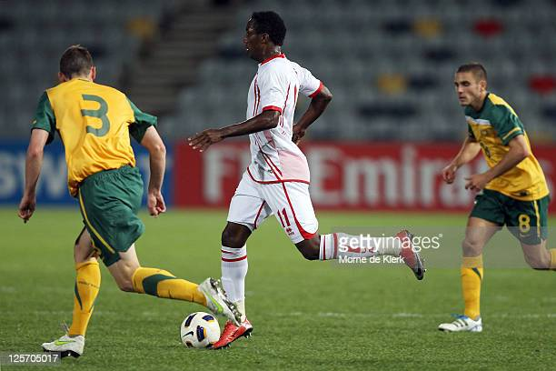 Ahmed Khalil Sebait Mubarak Aljunaibi of the UAE runs with the ball during the third round 2012 Olympic Games Asian qualifier match between Australia...