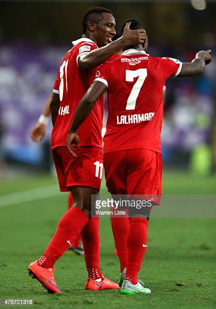 Ahmed Khalil Sebait Mubark Alkunaibi of Al Ahli is congratulated by team mate Ismail Salem Ismail Saeed Al Hammadi after scoring the first goal...
