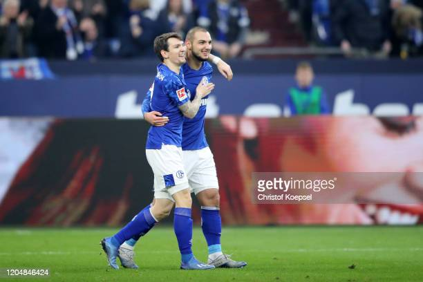 Ahmed Kutucu of FC Schalke 04 celebrates with teammate Benito Raman after scoring his team's first goal during the Bundesliga match between FC...