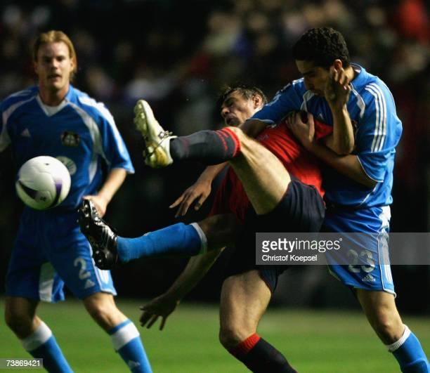 Ahmed Madouni of Leverkusen tackles Savo Milosevic of Osasuna during the UEFA Cup quarter final second leg match between CD Osasuna and Bayer...