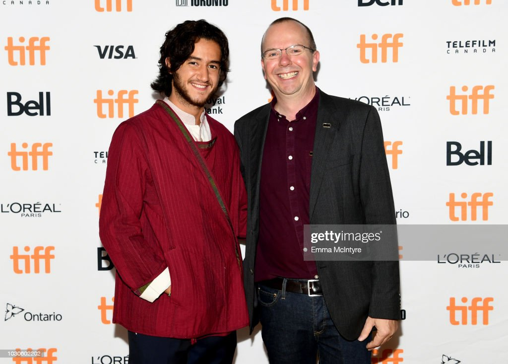 Ahmed Malek and IMDB founder and CEO Col Needham attend TIFF 2018