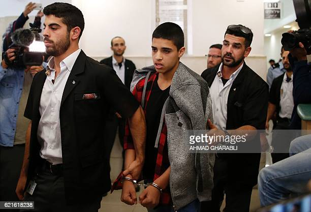 TOPSHOT Ahmed Manasra a 14year old Palestinian boy convicted of the attempted murder of two Israelis in a stabbing in October 2015 leaves the...