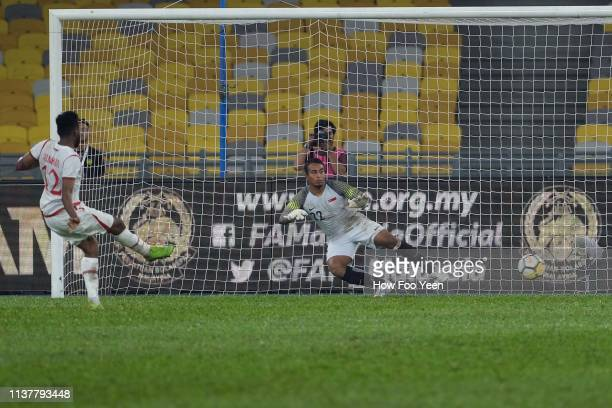 Ahmed Mubarak Obaid of Oman in action during penalty shootout with Zairul Nizam of Singapore during the Airmarine Cup final between Singapore and...