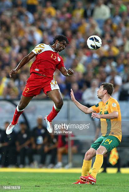 Ahmed Mubarak of Oman competes for the ball against Brett Holman of the Socceroos during the FIFA 2014 World Cup Qualifier match between the...