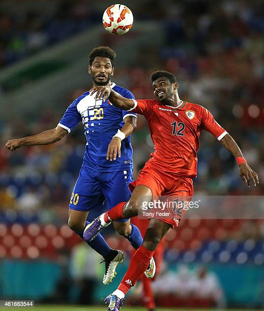 Ahmed Mubarak of Oman contests a header with Yousef Naser of Kuwait during the 2015 Asian Cup match between Oman and Kuwait at Hunter Stadium on...