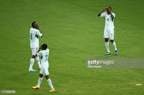 Ahmed Musa Brown Ideye and Mohammed Gambo of Nigeria show their dejection during the FIFA Confederations Cup Brazil 2013 Group B match between...