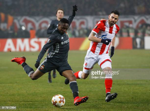 Ahmed Musa of CSKA Moscow in action against Damien Le Tallec of Crvena Zvezda during UEFA Europa League Round of 32 match between Crvena Zvezda...