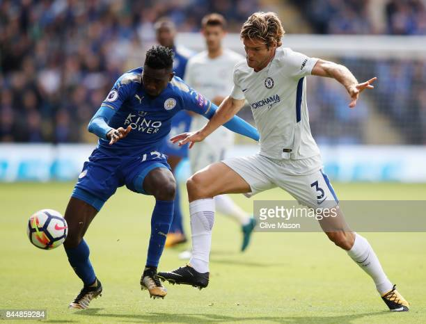 Ahmed Musa of Leicester City and Marcos Alonso of Chelsea battle for possession during the Premier League match between Leicester City and Chelsea at...