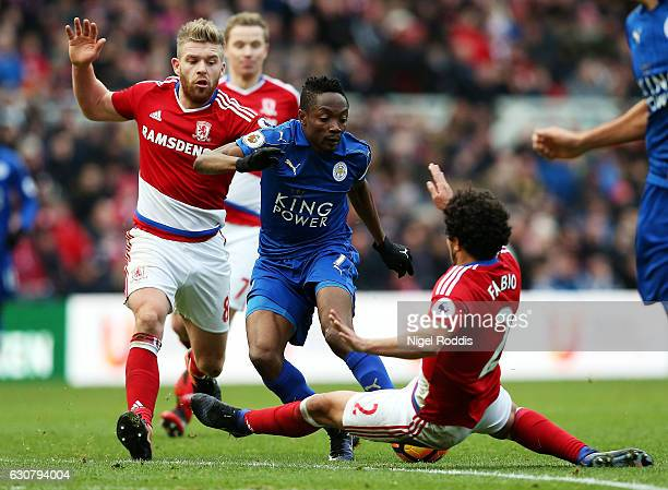 Ahmed Musa of Leicester City attempts to tackle the ball past Adam Clayton of Middlesbrough and Fabio Da Silva of Middlesbrough during the Premier...