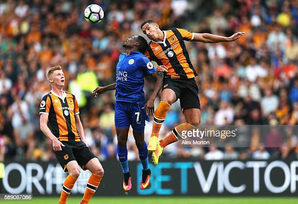 Ahmed Musa of Leicester City battle for possession in the air with Jake Livermore of Hull City during the Premier League match between Hull City and...