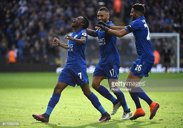 Ahmed Musa of Leicester City celebrates scoring his sides first goal with his team mate Danny Simpson and Riyad Mahrez during the Premier League...