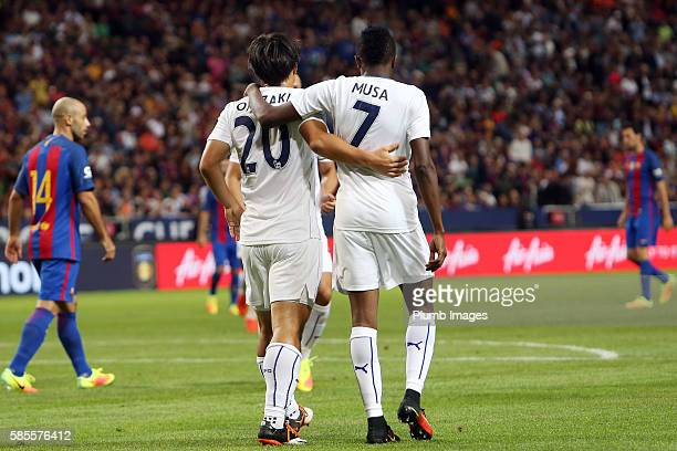 Ahmed Musa of Leicester City celebrates with Shinji Okazaki of Leicester City after scoring to make it 13 during the International Champions Cup...