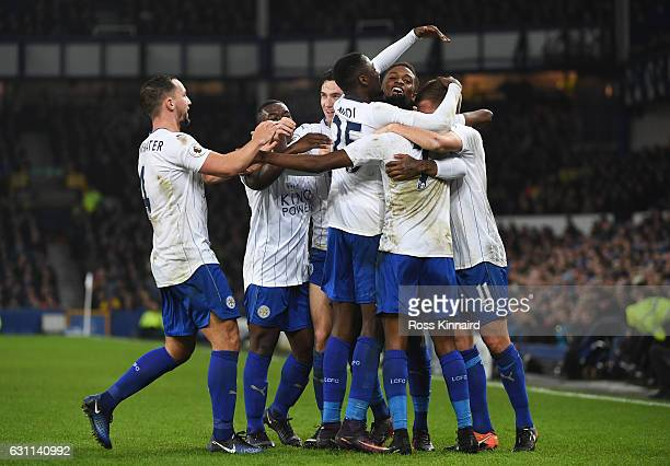 Ahmed Musa of Leicester City celebrates with team mates after scoring his sides first goal during the Emirates FA Cup third round match between...