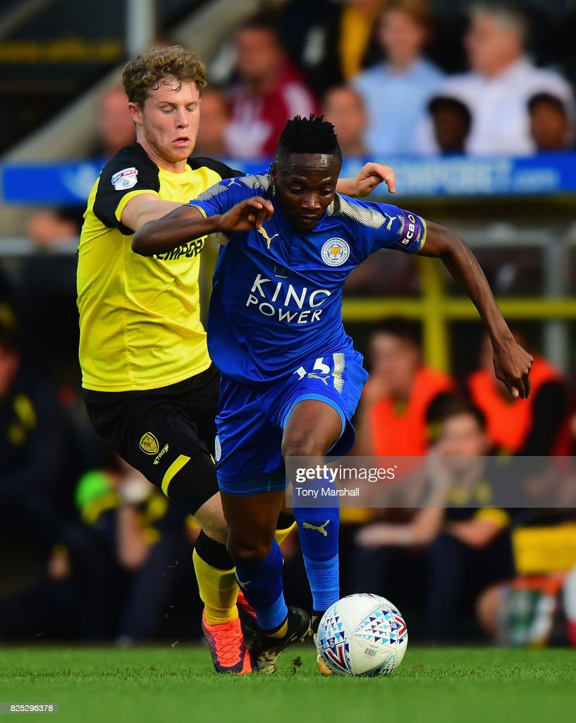 Ahmed Musa of Leicester City holds off a challenge from Matty Palmer of Burton Albion during the Pre-Season Friendly match between Burton Albion v Leicester City at Pirelli Stadium on August 1, 2017 in Burton-upon-Trent, England.