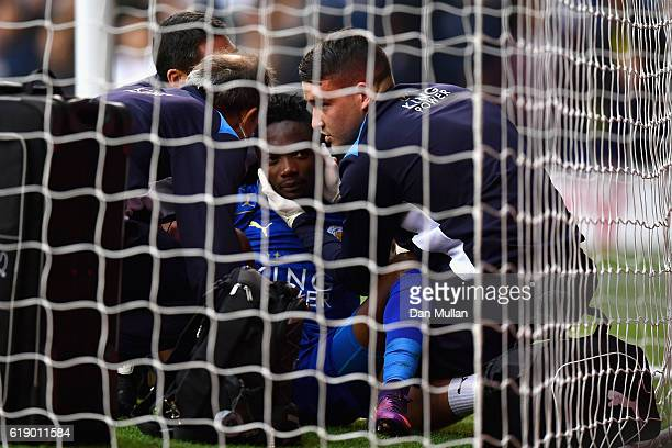 Ahmed Musa of Leicester City receives medical treatment after scoring his team's first goal during the Premier League match between Tottenham Hotspur...