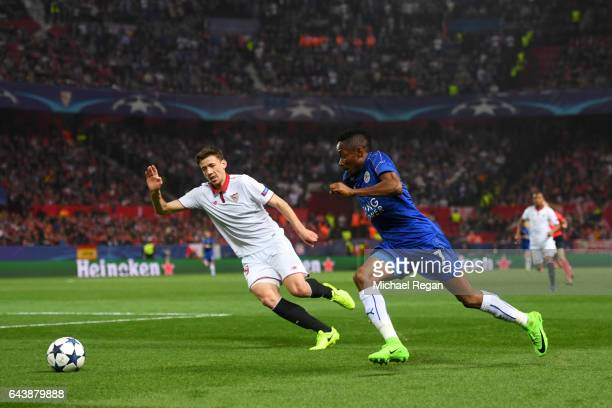 Ahmed Musa of Leicester City runs with the ball under pressure from Clement Lenglet of Sevilla during the UEFA Champions League Round of 16 first leg...