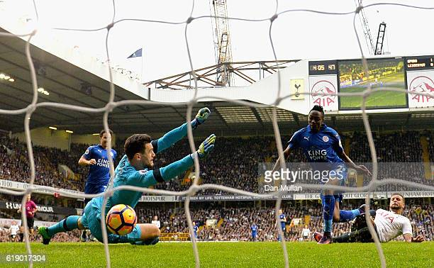 Ahmed Musa of Leicester City scores his sides first goal past Hugo Lloris of Tottenham Hotspur during the Premier League match between Tottenham...