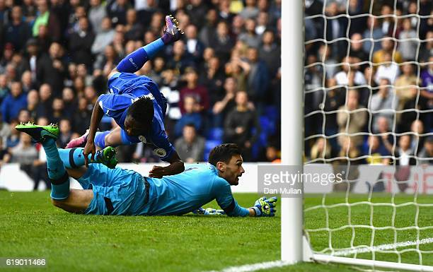 Ahmed Musa of Leicester City scores his team's first goal past Hugo Lloris of Tottenham Hotspur during the Premier League match between Tottenham...