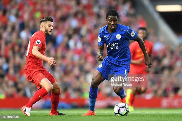 Ahmed Musa of Leicester City takes the ball past Adam Lallana of Liverpool during the Premier League match between Liverpool and Leicester City at...