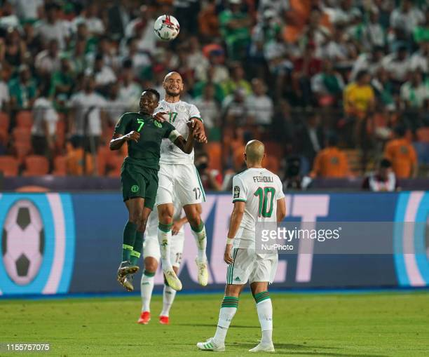 Ahmed Musa of Nigeria and Adlane Guedioura of Algeria challenging for the ball during the 2019 African Cup of Nations match between Algeria and...