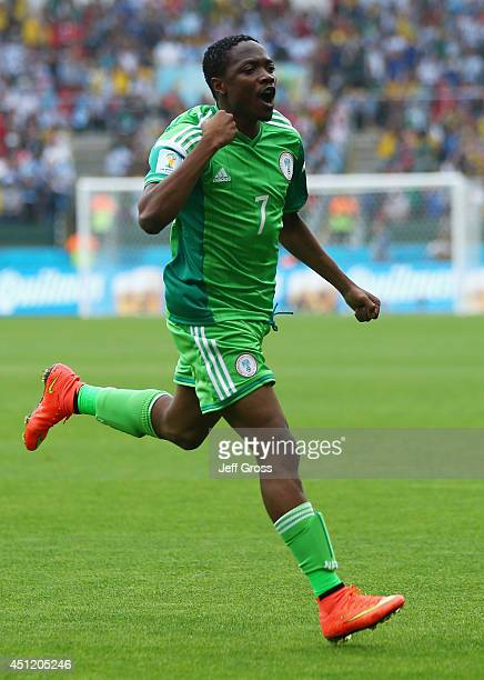 Ahmed Musa of Nigeria celebrates scoring his team's first goal during the 2014 FIFA World Cup Brazil Group F match between Nigeria and Argentina at...