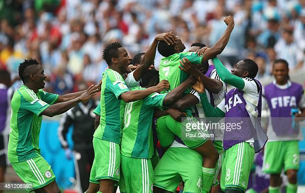 Ahmed Musa of Nigeria celebrates scoring his team's second goal and his second of the game with teammates during the 2014 FIFA World Cup Brazil Group...