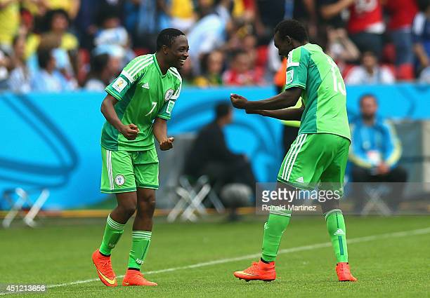 Ahmed Musa of Nigeria celebrates with teammate Juwon Oshaniwa after scoring his team's second goal and his second of the game during the 2014 FIFA...