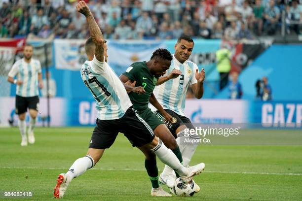 Ahmed Musa of Nigeria clashes with Nicolas Otamendi and Nicolas Tagliafico of Argentina during the 2018 FIFA World Cup Russia group D match between...