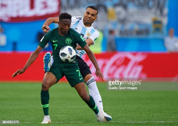 Ahmed Musa of Nigeria competes for the ball with Gabriel Mercado of Argentina during the 2018 FIFA World Cup Russia group D match between Nigeria and...