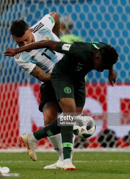 Ahmed Musa of Nigeria national team and Nicolas Otamendi of Argentina national team vie for the ball during the 2018 FIFA World Cup Russia group D...