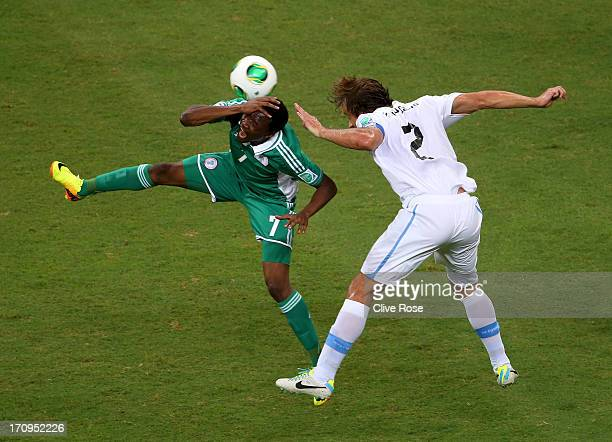 Ahmed Musa of Nigeria tangles with Diego Lugano of Uruguay during the FIFA Confederations Cup Brazil 2013 Group B match between Nigeria and Uruguay...