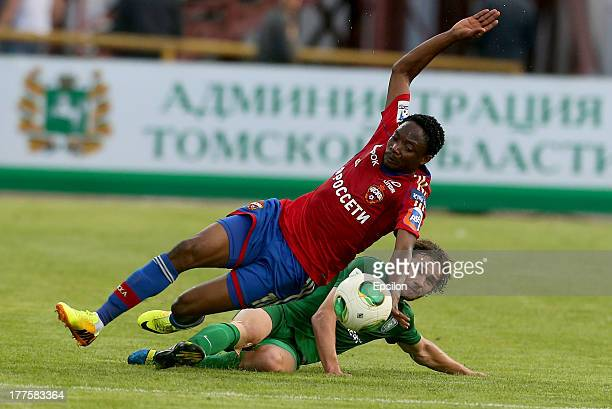 Ahmed Musa of PFC CSKA Moscow in action against Yevgeni Bashkirov of FC Tom Tomsk during the Russian Premier League match between FC Tom Tomsk and...