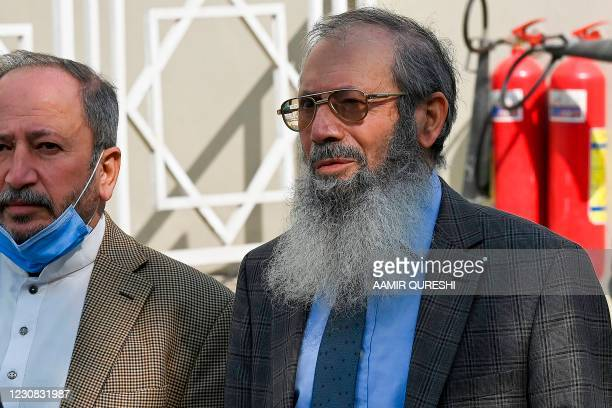 Ahmed Omar Saeed Sheikh's father Saeed Sheikh speaks with the media outside the Supreme Court building in Islamabad on January 28 after the court...