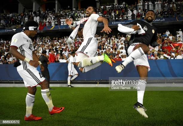 Ahmed Rabia Salim Rashid and Salim Ali of AlJazira celebrate after the FIFA Club World Cup match between Al Jazira and Urawa Red Diamonds at Zayed...