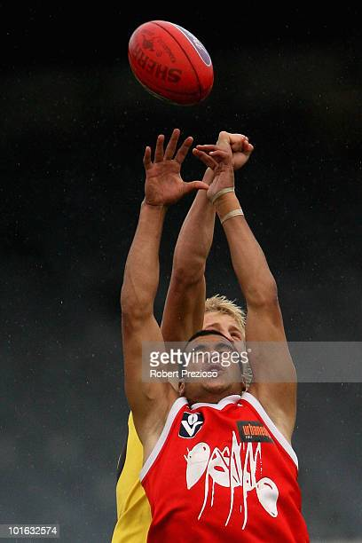 Ahmed Saad of the Bullants flies for a mark as Matthew Shaw of the Gold Coast attempts to spoil during the round eight VFL match between the Bullants...