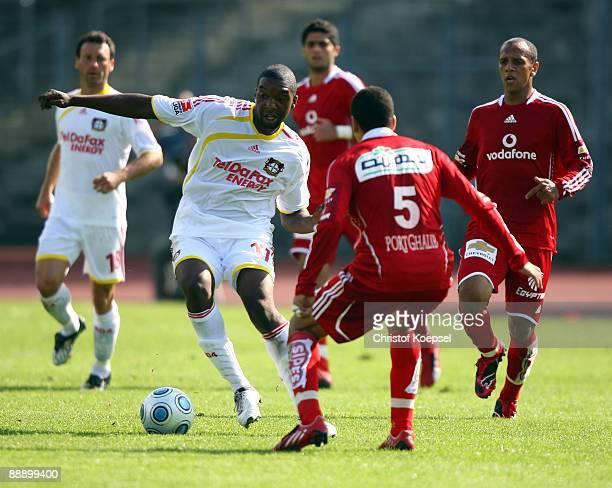 Ahmed Sayid of Al Ahly tackles Richard SukutaPasu of Leverkusen during the Zayton Cup match between Bayer Leverkusen and Al Ahly at the Lorheide...