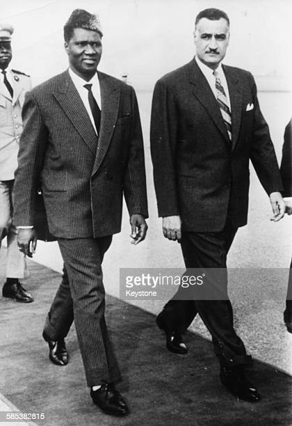 Ahmed Sekou Toure President of Guinea walking with Egyptian President Gamal Abdel Nasser at Cairo Airport circa 1965