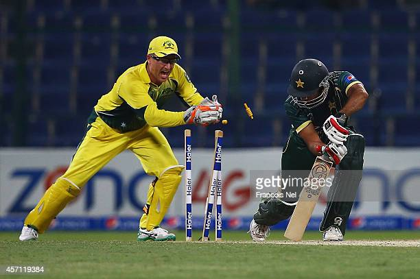 Ahmed Shahzad of Pakistan is stumped by Brad Haddin of Australia during the third match of the one day international series between Australia and...