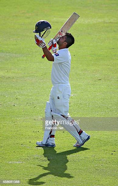 Ahmed Shehzad of Pakistan celebrates after reaching his century during Day One of the First Test between Pakistan and New Zealand at Sheikh Zayed...