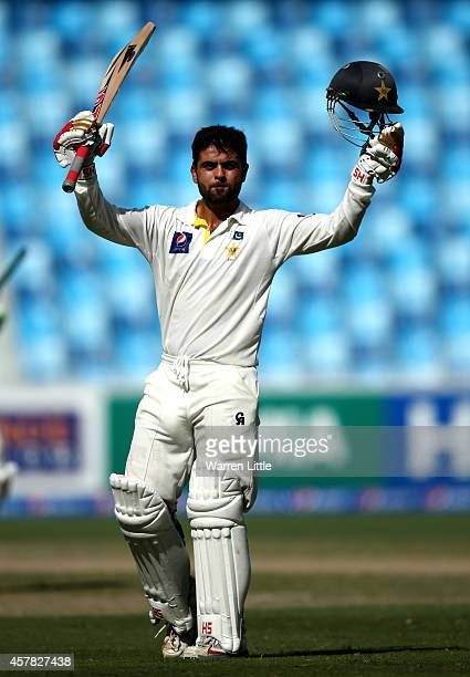Ahmed Shehzad of Pakistan celebrates as he reaches his century during day four of the First Test between Pakistan and Australia at Dubai...