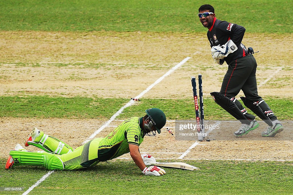 Ahmed Shehzad of Pakistan is run out during the 2015 ICC Cricket World CUp match between Pakistan and the United Arab Emirates at McLean Park on March 4, 2015 in Napier, New Zealand.