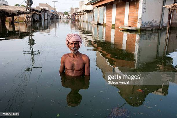Ahmed stands in the centre of the town of Khairpur Nathan Shah which had been totally submerged by floodwaters. The floods in Pakistan have caused...