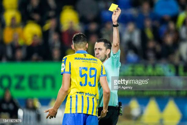 Ahmed Touba of RKC Waalwijk receives a yellow card by referee Dennis Higler during the Dutch Eredivisie match between RKC Waalwijk and Willem II at...